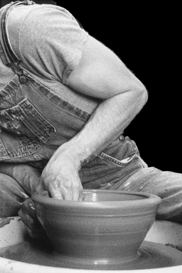 throwing a bowl on the potters wheel